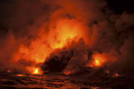 Smoke clouds from lava flow impacting sea at night, Kilauea volcano, Hawaii - ISF18212