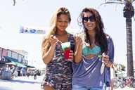 Female friends with iced drink, Hermosa Beach, California, USA - ISF18359