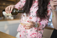 Close-up of woman pouring white wine into glass - AWF00147