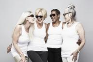 Studio portrait of senior women friends having fun - ISF18520