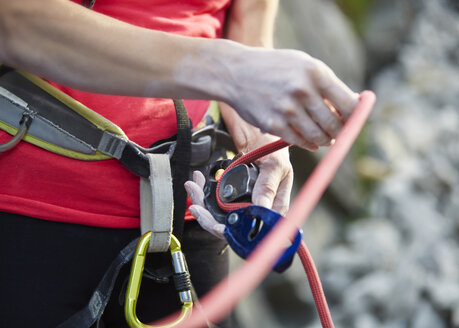 Close-up of female climber with climbing equipment - CVF00999