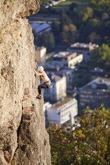 Austria, Innsbruck, Hoettingen quarry, woman climbing in rock wall - CVF01011