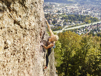 Austria, Innsbruck, Hoettingen quarry, woman climbing in rock wall - CVF01014