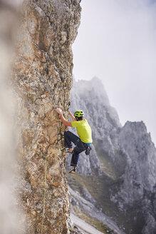 Austria, Innsbruck, Nordkette, man climbing in rock wall - CVF01020