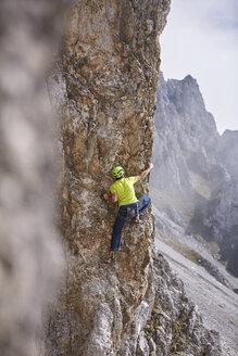 Austria, Innsbruck, Nordkette, man climbing in rock wall - CVF01023