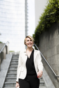 Portrait of smiling businesswoman - GIOF04011