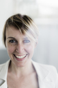 Portrait of laughing businesswoman - GIOF04014