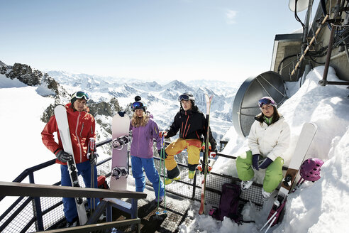 Group of skiers on ski lift stairs - ISF18527