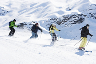 Group of friends skiing down mountain - ISF18548