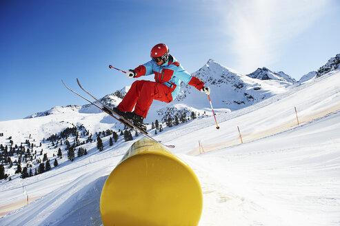 Skier doing tricks on pole - ISF18551