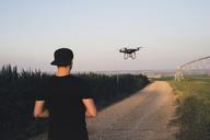 Man flying drone in a field - ACPF00150