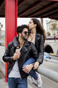 Spain, Barcelona, affectionate young couple in the city - MAUF01581