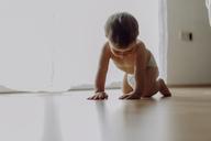 Little baby boy crawling on floor - JLOF00128