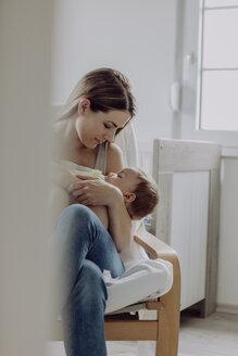 Mother feeding her baby son - JLOF00143