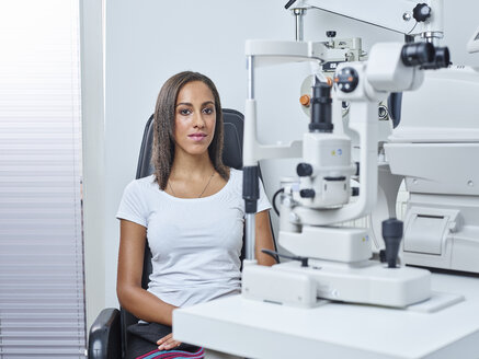 Optician, Young woman before eye test - CVF01033