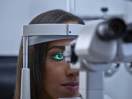 Optician, Young woman during eye test - CVF01036