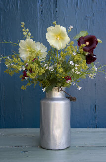 Bunch of wildflowers in milk can - GISF00355