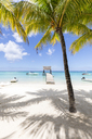 Mauritius, Pamplemousses District, Trau-aux-Biches, View from palm beach to roofed landing stage - MMAF00441