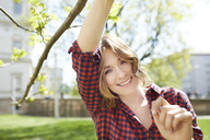 Portrait of smiling woman outdoors - PNEF00787