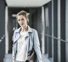 Portrait of confident businesswoman in office passageway - UUF14695