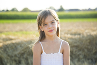 Portrait of smiling little girl in nature - LVF07355