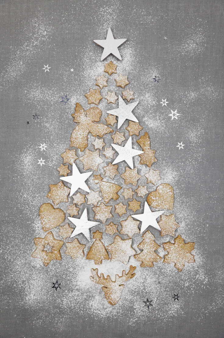 Christmas cookies and white stars forming Christmas Ttee on grey background - GWF05618 - Gaby Wojciech/Westend61