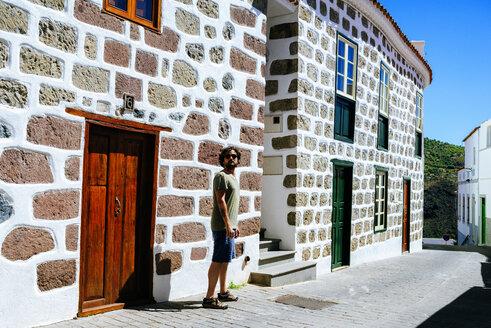 Spain, Canary Islands, Gran Canaria, Man walking through Tejeda - KIJF01982