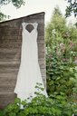 Wedding dress hanging on garden shed - ISF19389