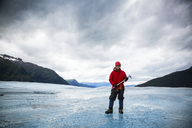 Man with ice pick on Mendenhall Glacier, Alaska, USA - ISF19542