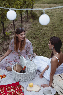 Friends having a summer picnic in vineyard - MAUF01621