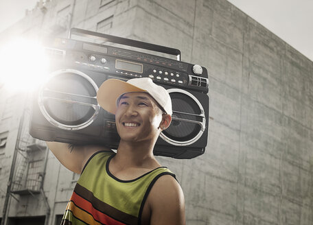 A young person with a boom box on the street of a city. - MINF03112