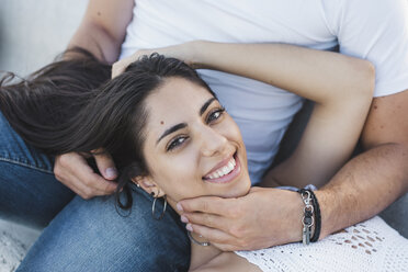 Happy young woman lying on lap of her boyfriend, portrait - AFVF01177