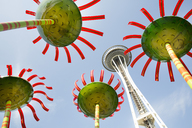 Low angle view of the Space Needle in Seattle, Washington, USA, with colourful flower sculptures. - MINF03920