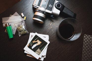 Marihuana, cigarette lighter, polaroids and analog camera on wood - KKAF01347