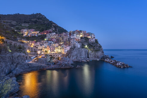 Italy, Liguria, La Spezia, Cinque Terre National Park, Manarola at blue hour - RPSF00216