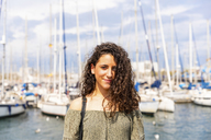 Portrait of smiling teenage girl at a marina - WPEF00760