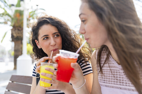 Two female friends enjoying a fresh slush - WPEF00763