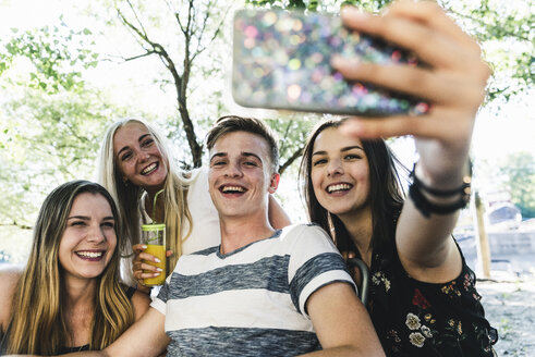Group of happy friends taking a selfie outdoors - UUF14869