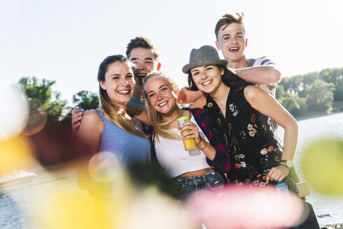 Portrait of group of happy friends at the riverside - UUF14887