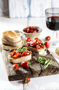 Italian buschetta and glass of red wine - SBDF03718