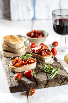 Italian buschetta and glass of red wine - SBDF03718