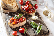 Italian buschetta on chopping board - SBDF03721
