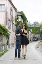 France, Paris, young couple in an alley in the district Montmartre - AFVF01249