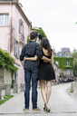 France, Paris, young couple in an alley in the district Montmartre - AFVF01252