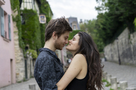 France, Paris, young couple in an alley in the district Montmartre - AFVF01255