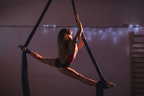 Aerial silks performer during a performance - MAUF01671