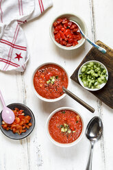 Two bowls of Gazpacho and bowls of ingredients - SBDF03725