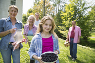A family summer gathering at a farm. A shared meal, a homecoming. - MINF04939