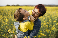Mother having fun with her little son in a rape field - JRFF01794