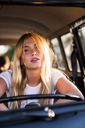 Portrait of young woman in a van - KKAF01386